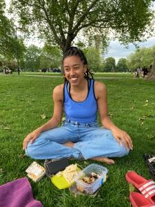Georgis sat in a park in London Fields.