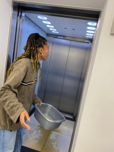 Cleaning up the spilt bottle of coke in the lift.
