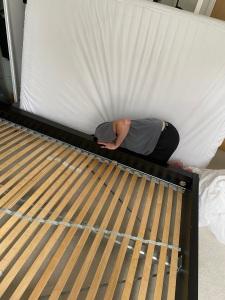 Fixing a broken bed.